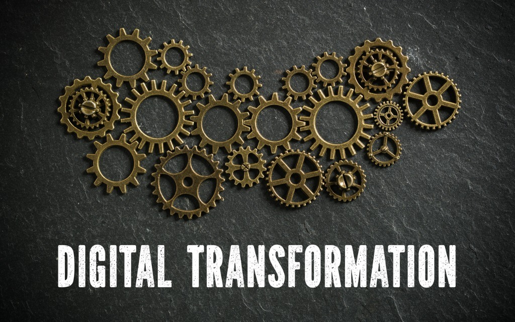 写真-cogwheels-and-the-words-digital-transformation-on-slate-background-a-picture-id1090973498